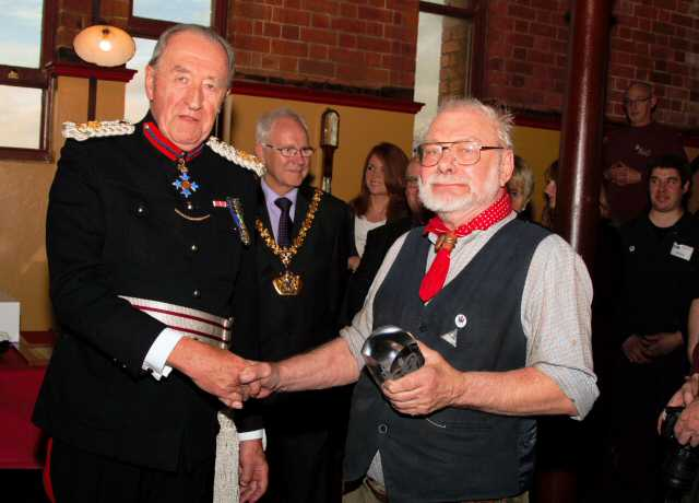 The commemorative crystal was presented by The Vice Lord-Lieutenant of Staffordshire, Colonel Michael Beatty, to one of the longest serving volunteers, Bill Britland