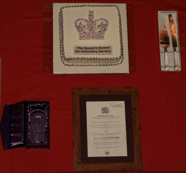 The commemorative crystal, certificate, signed by Her Majesty and the celebration cake.